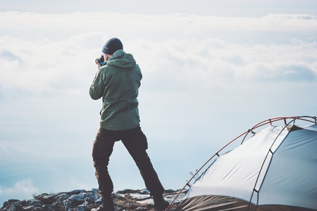 Backpacker Photographing Scenic Location