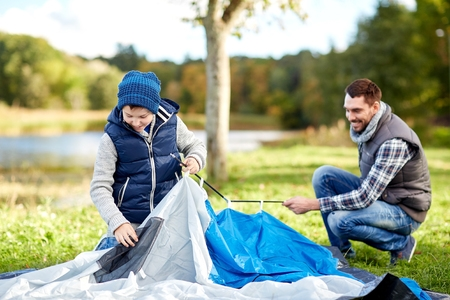 Father and Son Put up a Tent
